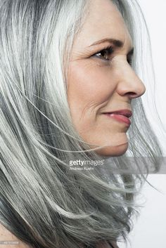 Stock Photo : Grey haired woman with a soft smile, profile.