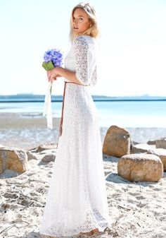 This gorgeous floral maxi lace dress features floral lace 3/4 sleeves. It comes with a chic braided-leaves belt to help accentuate curves and to add feminine touch to the dress. | Lookbook Store Dress