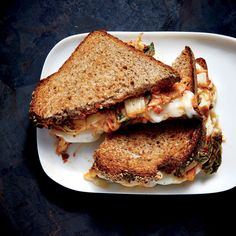 Kimchi Grilled Cheese | Tangy-spicy kimchi brightens the taste of a rich, toasty grilled cheese sandwich. We use a combination of two cheeses for the best flavor and texture. Fresh mozzarella is creamy, slightly firm when melted, and mild enough to allow the kimchi to shine; Monterey Jack is ultra creamy when melted and slightly tangy, which echoes the taste of the kimchi. The kimchi retains some crunch in the sandwich, creating a great textural contrast to the soft cheese.