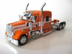 DCP Kenworth W900L Orange/White Striped Color Diecast Promotions 1/64th Scale Model Truck Kits, Model Kits, Kenworth Trucks, Toy Trucks, Custom Big Rigs, Diecast Model Cars, Semi Trucks, Classic Toys, Building Toys