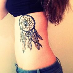 tattoos of dream catchers for girls | http://www.tattoobite.com/nice-dream-catcher-tattoo-on-ribs-for-girls/