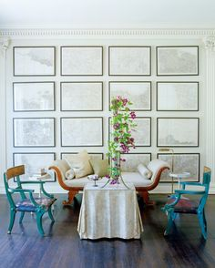 """Eye-Candy Interiors from Carlos Mota's """"A Touch of Style"""" - Bright flowers and furniture pop against a crisp gallery wall."""