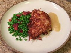 Potato Crusted Pork Chops with Peas and Bacon - Michelle's Recipe Binder..you can make this dinner for about $2 per serving!!