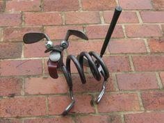 Upcycled golf club dog yard art