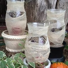 Make Halloween mummies for your yard from hurricane glass shades & strips of cheesecloth.
