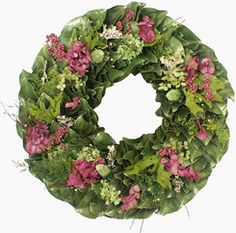Vibrant green and raspberry-colored hydrangeas, spring oak leaves, pink pepperberries, lichens and wisps of caspia combine to create this beautiful spring magnolia wreath. Magnolia branches cut from the family farm, hand-made into a wreath, and dried to perfection create the perfect backdrop for these pink accents. One of our very favorites!!