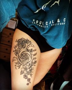 Floral thigh tattoo with Roses, Bluebells and other flowers and foliage