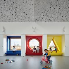 Portholes connect community centre and kindergarten in Cambridge Daycare Design, Playroom Design, Nursery Design, School Design, Kindergarten Interior, Kindergarten Design, Kindergarten Centers, Kids Cafe, Nursery Pictures