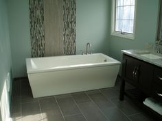 Bathroom Remodel by Litt's Plumbing Kitchen & Bath Gallery. Featuring Jason soaking tub and Dal Tile.