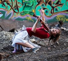 Lindsey Stirling. This woman makes playing the violin seem like more fun than anything I've ever done