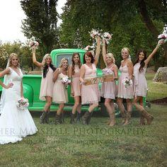 Rustic vintage wedding. Mismatched blush pink Bridesmaids dresses with cowboy boots.