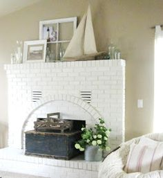 The Wicker House: Bottles and Driftwood Mantel
