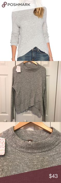 Free People Mock-Neck Boho Wrap Sweater This Free People Sweater is NWT.  It is a gray marled color and has a crossover detail in the front.  Bust 20, Length in front 23, length in back 26.  No fabric content available.  However, when found on a website says that it is a linen, cotton, polyester blend. Hand wash or dry clean.  From a smoke free, pet friendly home. Free People Sweaters Crew & Scoop Necks