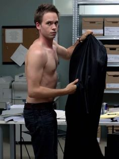 Patrick J. Adams shirtless in a scene from Suits...