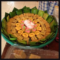 "Kueh Nampan. Indonesian traditional plating art for sweets using wide plate called ""nampan"", garnish with banana leaf."