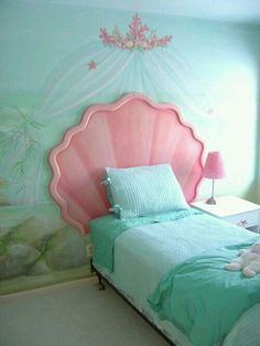Beautiful under the sea, ocean, mermaid, relaxing or however you see it bedroom. For your little girl or even yourself :) My looking at the picture this looks like a easy to medium dyi project. The headboard can be done with foam, cardboard & paint. The mural can be purchase or painted. G;)