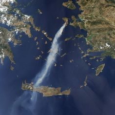 In this image captured by a Nasa satellite, a thick plume of smoke from an intense wildfire on the Greek island of Chios can be seen drifting southward toward the island of Crete Southern Europe, Earth From Space, Pictures Of The Week, Natural Phenomena, Crete, Chios Greece, Greek Islands, Beautiful World, Around The Worlds