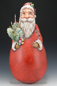 Vintage bouquet Santa gourd, large (18 inches tall and 9 inches in diameter) - A unique, one of a kind Santa Claus creation designed, sculpted, painted by hand and signed by the artist, Sheryl Parsons.
