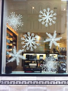 Large mdf snowflakes cut for a hairdressers window