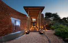 The stylish, secluded Marataba Safari Lodge combines opulent luxury and refined service with the experience of the Big 5 game and unique landscape. Luxury Glamping, Luxury Tents, Hotel Architecture, Architecture Details, Open Plan Bathrooms, Forest Hotel, Entrance Design, Resort Villa, Natural Building