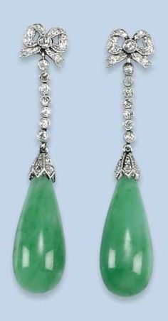 A PAIR OF BELLE EPOQUE JADE AND DIAMOND EARRINGS, CIRCA 1915. Each composed of a pear-shaped jade drop surmounted by a millegrain diamond-set line and ribbon. #BelleÉpoque #earrings
