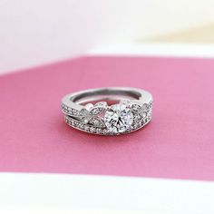 This gorgeous diamond hybrid wedding set is sure to give you butterflies!
