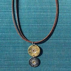 Awesome Shotgun Shell Necklace! Check out this beautiful two tone brown necklace with a gold-silver double shotgun shell pendant made by Spent Rounds Designs!!! Shotgun Shell Jewelry | Bullet Jewelry | Ammo Jewelry