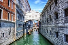 The Bridge of Sighs, also known as the Ponte dei Sospiri, is one of the most famous bridges of Venice. This curved, fully enclosed bridge is. Places Around The World, Around The Worlds, Sigh In, Famous Bridges, Travel Party, Most Beautiful Cities, Vacation Places, Venice Italy, Italy Travel