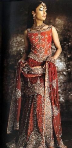 Bridal Lehenga in Rusty Orange: that's another color option but personally I think you should stick to the bright red/pink color
