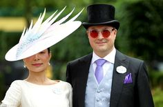 Well suited: Lord and Lady Oxmantown were among the guests who descended on Royal Ascot on day two