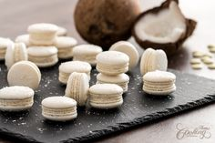 Coconut Macarons with Italian meringue method, uses shredded coconut in the shells as well as in the filling. The filling is made with white chocolate ganache and caramelized coconut for extra texture.