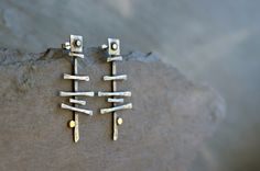 Trackway Offering - Sterling silver and gold post earrings by EarthenMe on Etsy https://www.etsy.com/listing/106781614/trackway-offering-sterling-silver-and