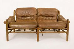 Safari Leather Sofa By Arne Norell for Scanfom, 1959 | From a unique collection of antique and modern sofas at http://wallin.1stdibs.com/furniture/seating/sofas/