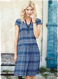 Combining the best of both worlds, this artfully striped blue frock has a soft jersey knit bodice for the fit and ease of a t-shirt, with a woven skirt for beautiful drape and movement. Styled with a dropped waist and pockets, the jersey bodice is viscose (94%) and elastane (6%) with a viscose skirt.
