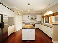Modern island kitchen design using exposed brick - Kitchen Photo 449422