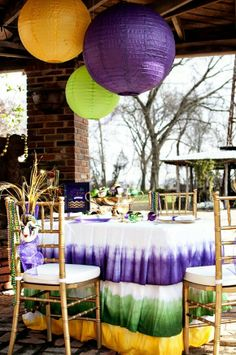 Mardi gras table décor... love the ombre dip dyed tablecloth