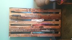 """With being in business for myself I wanted to find the perfect way to display my beautiful Park Lane jewelry for easy access. This is what I came up with: I placed a 5'2"""" long pallet against my office wall, hammered nails into the planks and hung my jewelry.    www.myparklane.com/wharbaugh"""