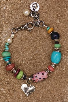 """~Pink Pineapple Summer bracelet... -Authentic Pink Pineapple trade bead (very rare & highly collectible) -Old Stock """"Little Bluebird"""" Turquoise (highly collectible) no longer mined -Chrysoprase -Number 8 turquoise (collectible) -Gaspeite (gorgeous piece & collectible) -Purple Spiney Oyster Shell -Yellow Jade -Black Australian Opal (sparkles in the light) -Artisan Sterling Silver -Handmade by me!  Bracelet is adjustable from 7.5"""" to 8.5"""""""