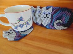 Cat Coasters Set Of Four in Needlepoint by BunniesMadeOfBread
