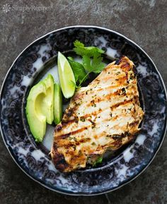 Grilled Cilantro Lime Chicken! Marinate skinless boneless chicken breasts in lime juice and cilantro marinade and then quickly grill to perfection. So easy! On SimplyRecipes.com