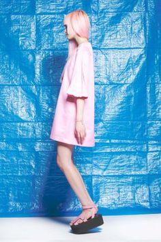 Poly sateen<br /> loose style<br /> box pleating in sleeve<br /> zipper & hook eye in back<br /> <br /> model wears size 6
