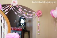 A Girly Party Theme: ♥ the circle streamers mixed in with the regular streamers, also  the napkin flowers! Tutorial for flowers...