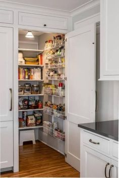 A white paneled cabinet doors opens to reveal a hidden kitchen pantry equipped w. - A white paneled cabinet doors opens to reveal a hidden kitchen pantry equipped with stacked white m - Kitchen Pantry Design, Pantry Closet, Kitchen Pantry Cabinets, Diy Kitchen Storage, Kitchen Shelves, Wall Storage, Diy Cupboards, Pantry Storage, Hidden Storage