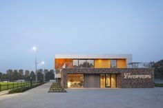 Image 11 of 16 from gallery of CVV Zwervers / MoederscheimMoonen Architects. Photograph by Luuk Kramer Soccer Academy, Arch Building, Facade, Mansions, House Styles, World, Gallery, Clubhouses, Sports