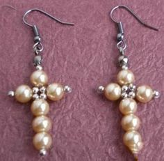 Ear rings for all your cross-bearing friends and relatives. The beads are strung (rather than wired).