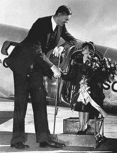 Alton Illinois Mary Pickford, Motion Picture Actress, being greeted at the St.Louis Airport by Robert Wadlow, the world's tallest man, 1938.