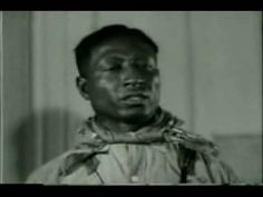 This is an excerpt from a 1935 March of Time newsreel (produced by Time magazine) which re-enacts Leadbelly's release from Angola Prison, Louisiana. John Lomax plays himself, and Leadbelly performs 'Goodnight Irene'.
