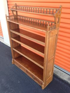 """Reduced from $400. TEAK wood 1850's  6 Shelf Bookcase Display Shelf W/ 3 Adjustable Shelves W Planks Slats for shelves. 57""""H x 42"""" W x 11""""D Top Shelf 6""""W / 2nd Shelf 11"""" W Bottom Shelf 11""""W ? 3- Adjustable Shelves 10"""" W EA. 2 Drawer's at Bottom RARE Furniture Item. <br> <br>Will consider trades for silver coins / Gold Jewelry  / Firearms ?"""
