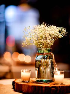 Candles and baby's breath in a mason jar, on a slab of wood, are the perfect rustic wedding centerpieces. Trendy Wedding, Dream Wedding, Wedding Rustic, Wedding Country, Wedding Vintage, Spring Wedding, Rustic Weddings, Elegant Wedding, Vintage Diy