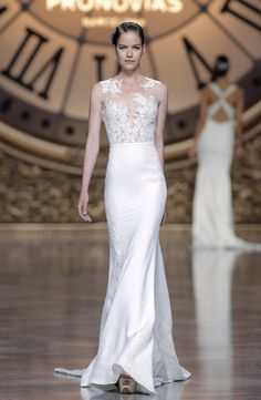 @pronovias Vincenta dress might seem simple on the bottom, but it's anything but that on the top. With gorgeous lace detailing at the neck that actually continues throughout the gown, it's a real standout.